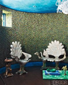 A pair of peacock chairs.