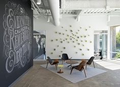 The Splendid Creative Large Reception Area with Chalk Artistry of The Company's Identity and A Coffee and Break Bar Built in Douglas Fir and Crafty Plant Wall Detail