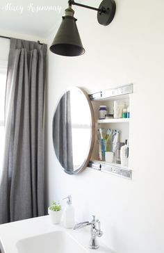 Round Sliding Bathroom Mirror | Stacy Risenmay #bathroommirror #mirrorwithstorage #storagemirror #bathroommedicinecabinet #medicinecabinet #roundmirror #roundbathroommirror #roundmedicinecabinet