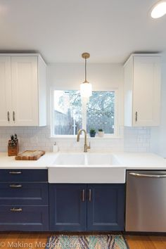 Budget Friendly Navy & Brass Kitchen — making modern home This is the EXACT look I'm going for. Blue bottom cabinets, white counter and white farmhouse sink. Blue Kitchen Cupboards, Brass Kitchen, Kitchen Redo, New Kitchen, Kitchen Fixtures, Kitchen Hardware, Navy Kitchen Cabinets, Country Kitchen, Kitchen White