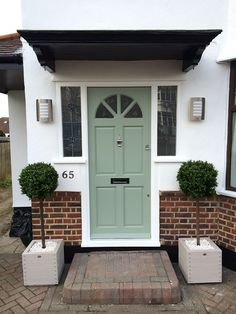 4ft Artificial Buxus Single Ball Trees from Red Hot Plants are used to give kerb appeal to this doorway.