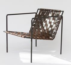 """Jednostavna i lijepa... A copper-plated or powdercoated (shown) hex-rod frame threads through a woven leather seat and back, resulting in a minimalist lounge with midcentury appeal. The chair measures 27"""" long, 25"""" wide, and 27"""" tall."""