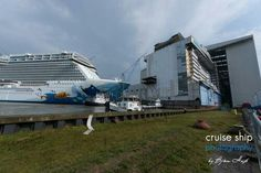 Ovation of the Seas Seaplex going back inside Meyer Werft Halle 6 passing Norwegian Escape