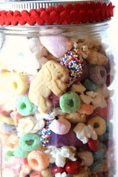 """Popcorn~classic circus snack, salted (1 micowave bag)  Clown Noses~red sixlets (1/2 cup)  Animal Hoops (for """"jumping through"""")~Froot Loops cereal (about 3 cups)  Peanuts~Favorite circus snack food for people, and elephants too:) (1 cup)  Cotton Candy~pink marshmallows, cut up (1 cup)  Clown Hats~candy-coated Bugles original, topped with m candies(2-3 dozen)-Directions  below  Circus Animals~Animal crackers (big handful)  More Circus Animals~iced animal crackers (big handful)"""