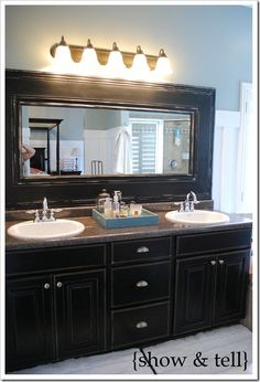 Bathroom mirror redo -  Finished my version of this yesterday and I LOVE it!!! I've always hated those stock mirrors in bathrooms. This is a great/easy/cheap way to customize your mirror.