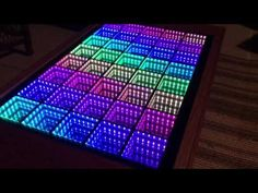 Beyond Infinity Table is a beautiful, interactive coffee table that will leave you amazed, bewildered, and maybe just a little dizzy! The sides are stained, clear. Mirror Ball, Led Mirror, Infinity Mirror Table, Led Dance, Game Room Decor, Diy Furniture Plans, Light Art, Rainbow Colors, Lights