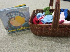 One Mitten book & basket of mittens-fun activities on this blog to go with book..