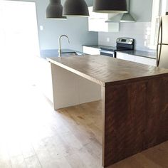 Kitchen project designed by DVS and featuring our reclaimed wood counter. The modern look of the cabinets and tiles paired with the richness and warmness of the wood is perfection. A great mix of modern and industrial. Oh and that natural light...