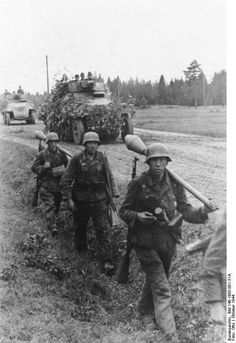German Großdeutschland Division troops on a road at Memel, East Prussia, Germany, Oct 1944; note Panzerfäuste, Kar98k rifles, and grenades  Photographer   Otto Source   German Federal Archive Identification Code   Bild 146-1995-081-31A
