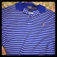 Blue and white striped polo. M_5ada9ea2331627c453c948a6