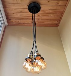 a Hanging Lights, Wood Chandelier, Industrial Pendant Lights, Rustic Light Fixtures, Chandelier Ceiling Lights, Wood Chandelier Rustic, Ceiling Fixtures, Edison Pendant Light, Wood Pendant Light