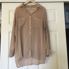 Oversized chiffon button up by American Apparel Oversized chiffon button up by. Color: nude/natural. Flaws are shown in pictures. (On left cuff there's a tear/small mark and under the arm is a little darker from wearing with dark colors). Otherwise, a great shirt! *EVERYTHING HAS TO GO!! MAKE AN OFFER!!!* American Apparel Tops Blouses