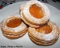 Biscotti Occhio di Bue Vegan - biscotti friabili e speziati farciti con confettura di mele