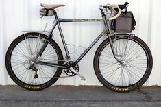 Mid-rider front and rear racks for small panniers with good ground clearance.