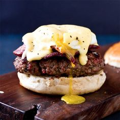 Eggs Benedict Burger: For the hollandaise sauce:  3 large egg yolks  1 Tbsp water  1 stick unsalted butter, cut into 8 pieces  Juice from 1/2 a lemon  Salt  Pepper  For the burgers  1 lb lean ground beef  Salt  Pepper  Worcestershire  3 eggs, fried or poached  3 slices of bacon, cooked to a crisp  Burger buns