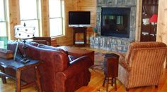Tryon Log Home living room created by Blue Ridge Log Cabins for High Rock Rentals #loghome #logcabins #cabins #highrockrentals #mountaincabin