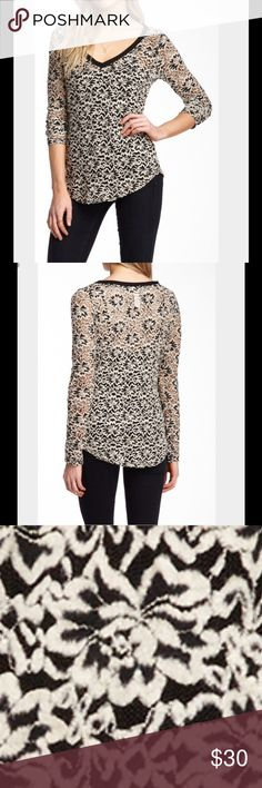 Nick & Mo Lace Tee V-neck, long sleeves, mesh construction with floral embroidery, curved hem. About23\