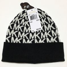 Michael Kors Beanie Black and white MK beanie. The back of the tag is torn, 2nd pic. Michael Kors Accessories Hats