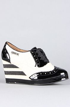 I was stoked when I saw Hush Puppies at the Outdoor Retailers Convention    The Anna Sui x Hush Puppies Oxford Wedge in Black Patent and White Canvas by Hush Puppies