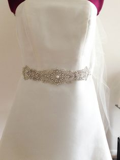 Nostalgic of precious jewelry, each MillieIcaro Sash is made from pearls, mounted swarovski crystals, and silk thread.