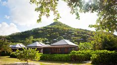 Hermitage Bay Resort  OBMI designed 25 individual cottages landscaped into the natural beauty of a perfect bay and hillside of tropical gardens.