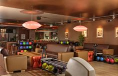 Bowling ball racks and leather seating.
