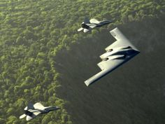 PsBattle: One United States Air Force (USAF) Spirit stealth bomber and two USAF Raptor stealth fighter jets photographed on 7 April 2009 in Territory of Guam USA Military Jets, Military Aircraft, Military Life, Air Fighter, Fighter Jets, Photo Avion, Stealth Bomber, Stealth Aircraft, F22 Raptor
