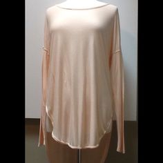 Free People We The Free Tunic Top Lovely, drapey, peachey hi-lo cut tunic.  Statuesque!  Feels so silky on.  Extra long sleeves.  Worn once. Free People Tops Tunics