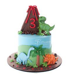 A bright dinosaur themed Birthday cake for a little boys 3rd Birthday.