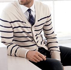 Shirt+tie with a great sweater/cardigan like this one,can give a classy look a gentleman needs. Try it!
