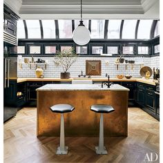 jeremiah-brent-nate-berkus-designed-greenwich-village home -- kitchen -- island: clad in unlacquered brass topped with Breccia Imperiale Marble from Artistic Tile - subway tile: Home Depot -- HighLow MIX