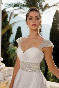 Have your Cinderella moment in this English net wedding ball gown adorned with detachable beaded sleeves. It features a beaded cummerbund and a sweep train. Lace Wedding Dress, Stunning Wedding Dresses, Wedding Gowns, One Shoulder Wedding Dress, Wedding Trends, Wedding Styles, Justin Alexander, Wedding Wraps, Ball Gowns