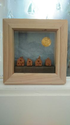 Little houses, air-drying clay with paper and foil