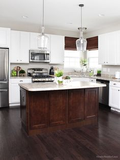 white kitchen cabinets dark island