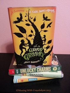 [Book Review] http://www.musingwithcrayolakym.com/3/post/2013/06/in-a-glass-grimmly.html