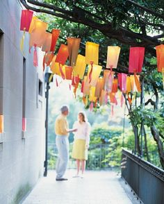 Outdoor party lights - string lights covered with colored paper bags!  A la Martha.