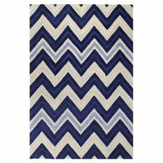 Chic chevrons define this hand-tufted wool rug, offering graphic style for your living room, dining room, or master suite.    Product: RugConstruction Material: 100% Wool Color: Ivory and navyFeatures: Hand-tufted Note: Please be aware that actual colors may vary from those shown on your screen. Accent rugs may also not show the entire pattern that the corresponding area rugs have.Cleaning and Care: Regular vacuuming and spot cleaning recommended