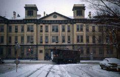 DCTransit snow sweeper leaving Navy Yard Carhouse on M Street SE turning onto Eighth Street (Navy Yard Latrobe Gate in background) (December 1960). [photo by Howard J. Wayt]: