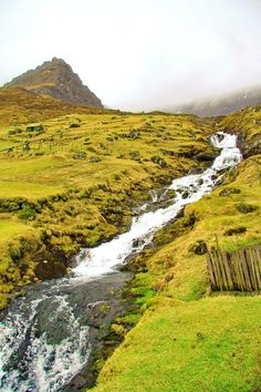 Waterfall, Faroe Islands, Denmark. The Faroe Islands is an archipelago and autonomous country within the Kingdom of Denmark, situated between the Norwegian Sea and the North Atlantic Ocean, approximately halfway between Norway and Iceland. (P)