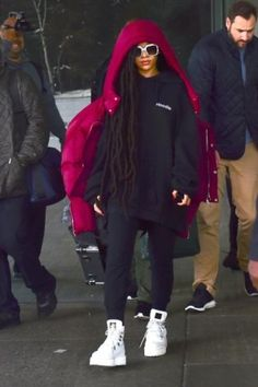 Rihanna wearing Trapstar Joggers, Fenty x Puma Platform Sneaker Boots, Gucci Oversize Square-Frame Rhinestones Sunglasses, Chen Peng Burgundy Puffer Jacket and Vetements Black Embroidered Hoodie