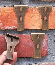 """Brick Clips to decorate instead of drilling. (approx. 2-3/4"""" x 1-1/2"""" x 3/8"""", each) They install by clipping directly to the brick. Supports up to 25 lbs. per clip. No holes to drill and no damage to bricks or mortar. Tempered spring steel. For use on standard bricks 2-1/8"""" to 2-1/2"""" high."""