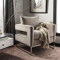 Furniture is art and this Safavieh accent chair understands that. An open back design built with pine wood creates a structured look among clean-lined furnishings, while the foam filled velvet cushions provide support and comfort. Colored in a swank Giotto Almond hue to accent the chrome silver legs, this geometric arm chair is a posh accent for penthouse style decor. #LoftInterior #Velvet #Comfort #Safavieh