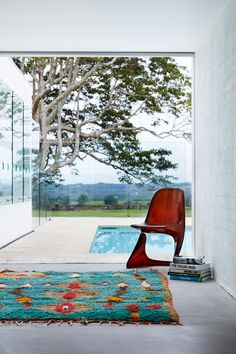 rustic carpet, stylish chair and a fantastic view