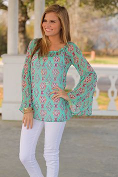 """This sheer blouse is amazing! The pattern on this top is so fun, and we cannot get enough of the gorgeous colors. Plus, how great are the bell sleeves? Slip this piece over a cami and white skinnies for the perfect outfit for spring!   Fits true to size. Kali is wearing a small.   From shoulder to hem:  Small - 25""""  Medium - 25.5""""  Large - 26""""  XL - 26.5"""""""