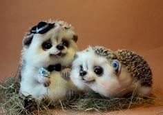 Needle felted hedgehog couple by Tatiana Barakova.