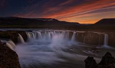 Goðafoss is probably the most spectacular waterfall in Iceland. The river Skjálfandafljót falls from a height of 12 meters over a width of 30 meters. It was after midnight, when I photographed the sunset. Summer in Iceland means: it never gets dark.  Press 'H' for black background. Thanks for your visit.