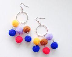 Etsy の Pom Pom Tassel Earrings by EkphrasisDesigns