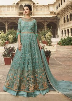 Aqua Embroidered Lehenga/Pant Style Anarkali features a net top with embroidery. Comes with banglori silk lehenga and embroidered pant with soft net embroidered dupatta. Lehenga Anarkali, Lehenga Choli Online, Silk Lehenga, Anarkali Suits, Sharara Suit, Ghagra Choli, Costumes Anarkali, Fashion Pants, Color