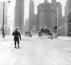 1967 storm: Tom Hall, of the Chicago Tribune, uses snowshoes to make his way to work on North Michigan Avenue.