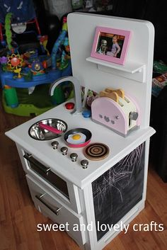 This is so cool! They made this with an old nightstand. I love that it even has a shelf for a picture!